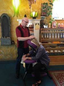 Storm performing a Reiki session during the 2013 Wisdom Festival at The Mystic Dream in Walnut Creek.